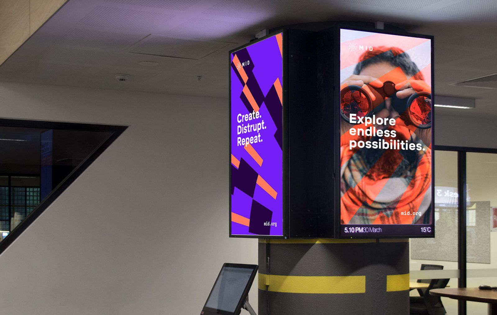 MID-branded digital screens in a university campus setting
