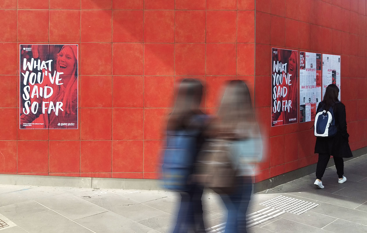 ShapeRMIT posters pasted on a red wall in a public space