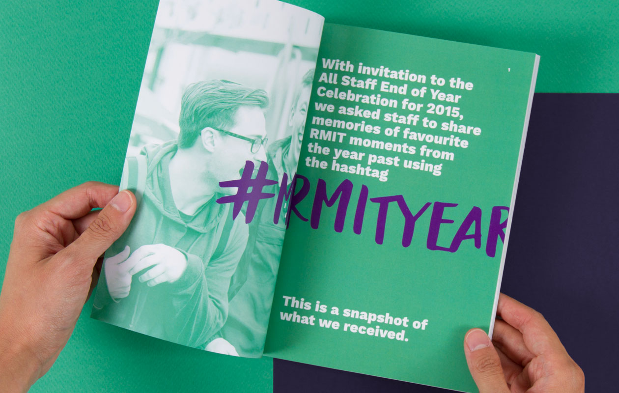 Hand holding open a spread of the My RMIT Year booklet